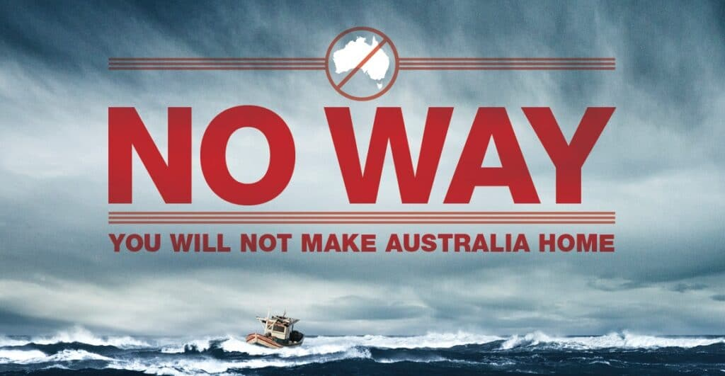 """An advertisement with large red letters saying """"NO WAY: You will not make Australia Home"""" against a background of a small fishing boat on rough seas."""
