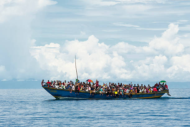 Lake Tanganyika, Tanzania - December 28, 2009: A crowded boat is transporting refugees on Lake Tanganyika from the DR Congo into Tanzania.