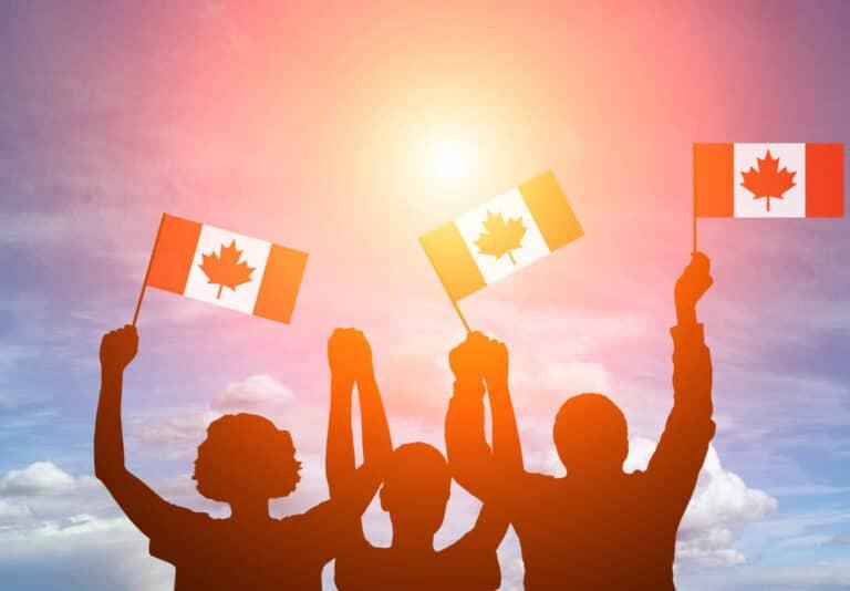 Cheering people waving Canadian flags